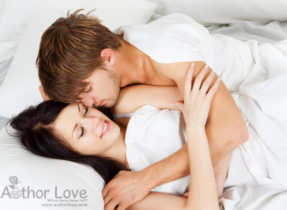 young-man-and-woman-in-bed-with-white-sheets