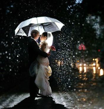 First-hug-afted-getting-married-in-rain-600x375